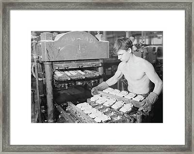 Worker Pressing Rubber Bodies For Doll Framed Print by Stocktrek Images