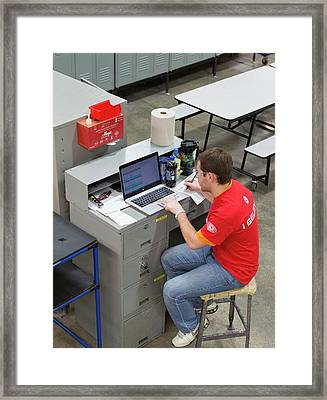 Worker Using Laptop In A Factory Framed Print by Jim West