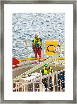 Workers Checking Level Of A Piece Framed Print by Ashley Cooper