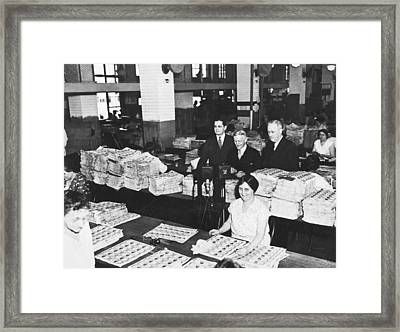 Workers Making Money Framed Print