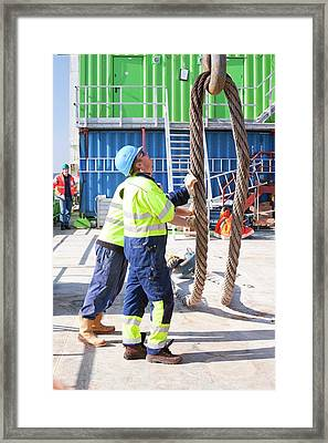 Workers Next To A Crane Hook Framed Print by Ashley Cooper
