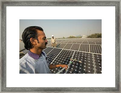 Workers Washing The Dust Off Solar Panel Framed Print