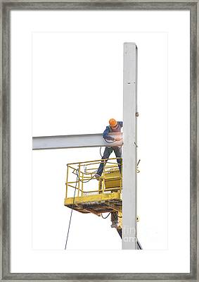 Workers Welded Steel Structures Framed Print by Anek Suwannaphoom