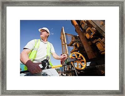 Workman Measuring Borehole Framed Print