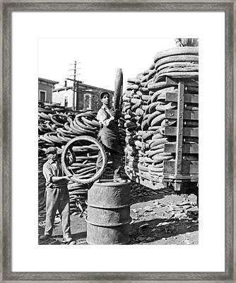 World's Largest Tire Pile Framed Print by -