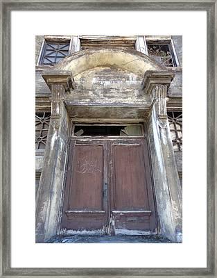 Worn Down Door Framed Print