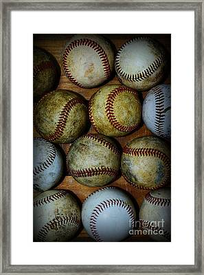 Worn Out Baseballs Framed Print by Paul Ward