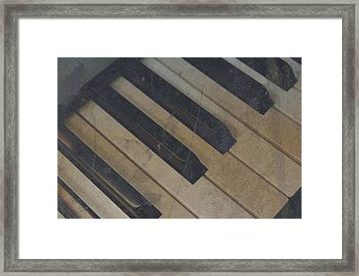 Framed Print featuring the photograph Worn Out Keys by Photographic Arts And Design Studio