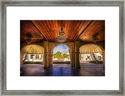 Worth Avenue Courtyard Framed Print by Debra and Dave Vanderlaan