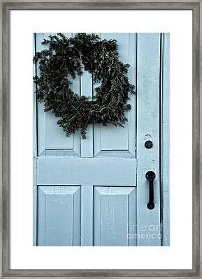 Wreath On Old Blue Door Framed Print by Birgit Tyrrell
