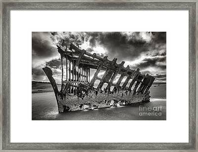 Wreck On The Shore Framed Print by Melody Watson