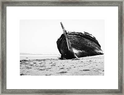 Wreckage On The Bay Framed Print by Marco Oliveira