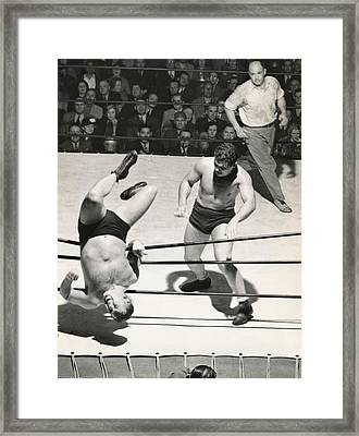 Wrestler Thrown Out Of Ring Framed Print by Underwood Archives
