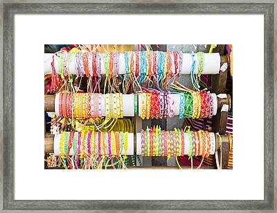 Wristbands Framed Print by Tom Gowanlock