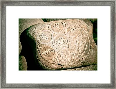 writing on the Tibetan language and Sanskrit at stone Framed Print by Raimond Klavins