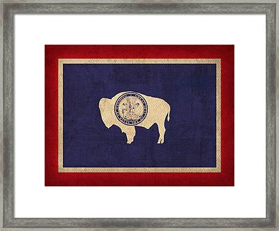 Wyoming State Flag Art On Worn Canvas Framed Print by Design Turnpike