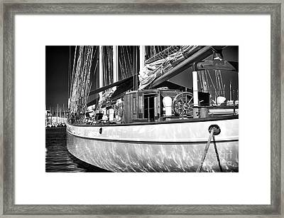 Yacht Reflections Framed Print by John Rizzuto