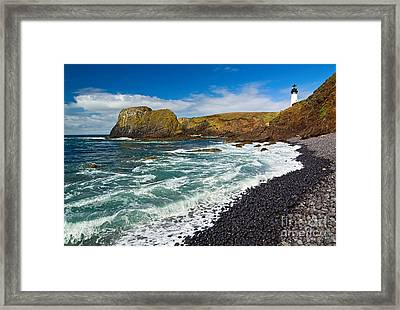 Yaquina Lighthouse On Top Of Rocky Beach Framed Print by Jamie Pham