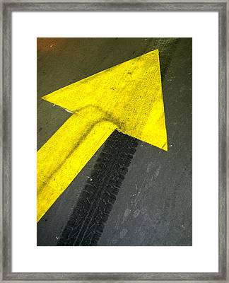 Yellow Arrow Sign On Road Framed Print by Panoramic Images