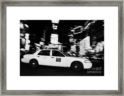 Yellow Cab At Speed In The Middle Of Times Square New York City At Night Framed Print by Joe Fox