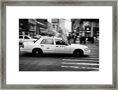 Yellow Cab Blurring Past Crosswalk And Pedestrians New York City Usa Framed Print