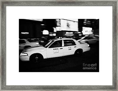 Yellow Cab In Times Square At Night New York City Framed Print by Joe Fox
