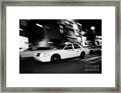 Yellow Cab New York City At Night Framed Print by Joe Fox