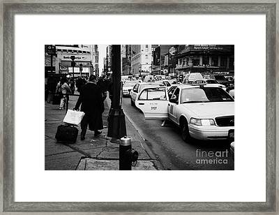Yellow Cab On Taxi Rank Outside Madison Square Garden On 7th Avenue New York City Usa Framed Print by Joe Fox