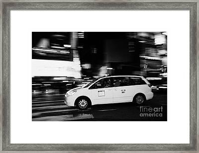 Yellow Cab Speeding Across Crosswalk In Times Square At Night New York City Framed Print by Joe Fox