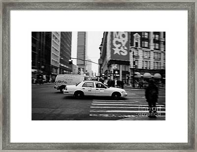yellow cab taxi blurs past pedestrian waiting at crosswalk on Broadway outside macys new york usa Framed Print by Joe Fox