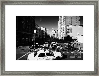 yellow cabs and pedestrians on crosswalk at junction of 1st Avenue and east 14th street st new york Framed Print by Joe Fox