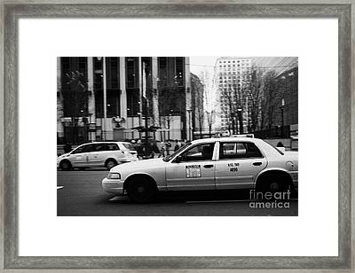 Yellow Cabs Blur Past Madison Square Garden On 7th Avenue New York City Usa Framed Print