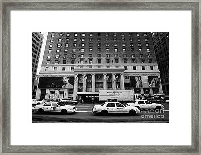 Yellow Cabs Go Past Pennsylvania Hotel On 7th Avenue New York City Usa Framed Print by Joe Fox