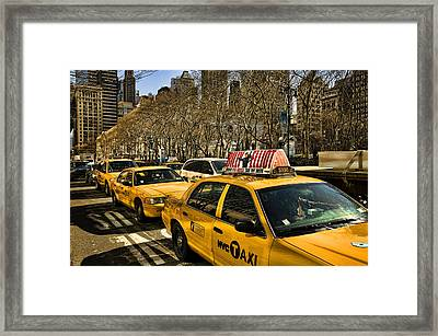 Yellow Cabs Framed Print by Joanna Madloch