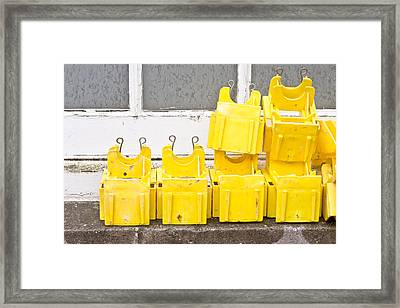 Yellow Caps Framed Print by Tom Gowanlock