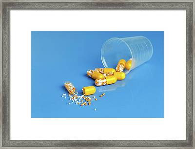 Yellow Capsules Framed Print