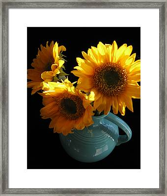 Framed Print featuring the photograph Yellow Flowers In Fiesta Pitcher by Patricia Januszkiewicz
