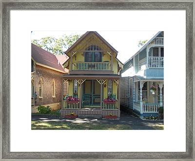 Yellow Gingerbread House Framed Print