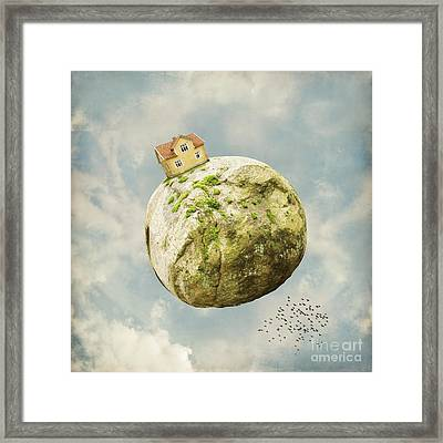 Yellow House In The Sky Framed Print
