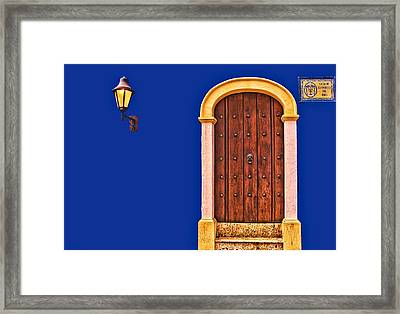 Door And Lamp Framed Print