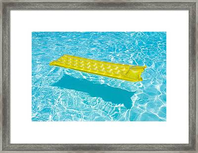 Yellow Raft Floating In A Pool Framed Print