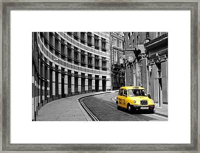 Yellow Taxi In London Framed Print by Jim Hughes