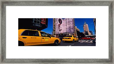 Yellow Taxies At The Road Intersection Framed Print by Panoramic Images