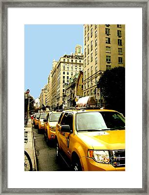 Yellow Taxis Framed Print by Claudette Bujold-Poirier