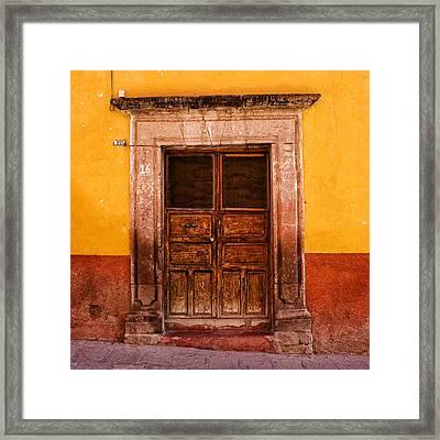 Yellow Wall Wooden Door Framed Print