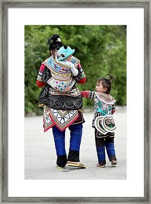 Yi Woman With Children Framed Print by Tony Camacho