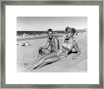 Young Adults On A Beach Framed Print by Underwood Archives