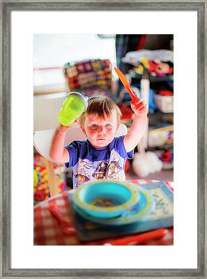 Young Boy At The Dinner Table Framed Print