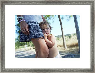 Young Boy Clinging On To His Mother Framed Print by Ruth Jenkinson