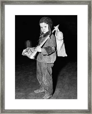 Young Boy Flees Floods Framed Print by Underwood Archives